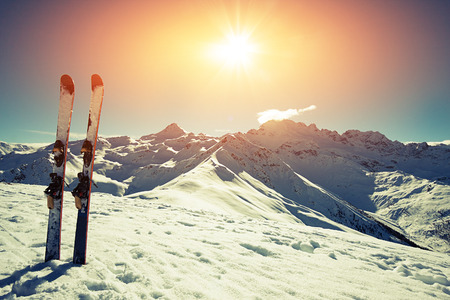 fresh snow: Skis in snow at Mountains Stock Photo