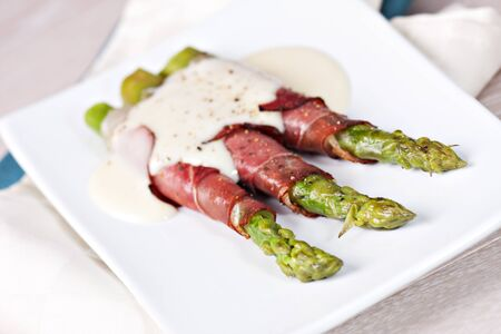 Ham rolls with asparagus and bechamel photo