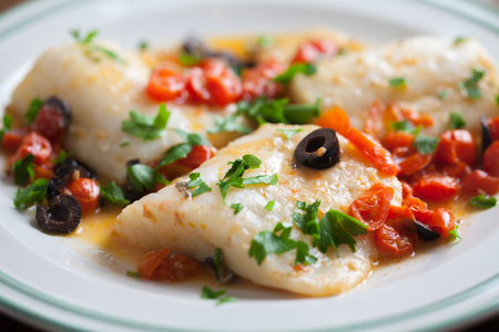 Fish fillet with cherry tomatoes and olives 写真素材