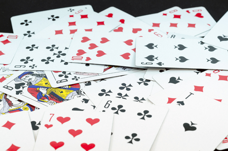 deck of playing cards isolated on black background Reklamní fotografie