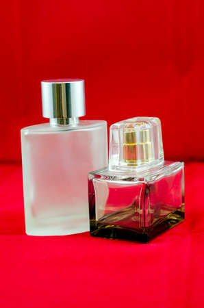 sensations: bottle of perfume isolated on a red background Stock Photo