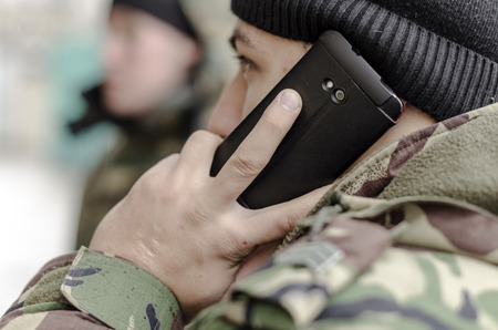 Military telephoned his superiors to report