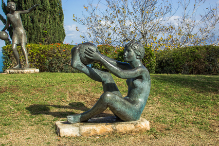 carmel: statue Girl playing with a ball in park on mount Carmel in Haifa, Israel