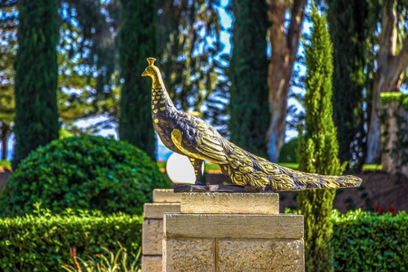 acre: gilded statue of a peacock in the temple of Bahai in Acre, Israel. Stock Photo