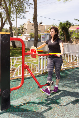 simulator: Woman in a sports simulator training on the playground outdoors