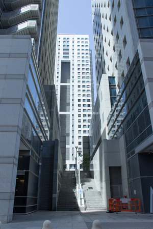 passages: The modern metropolis. Tall buildings and narrow passages between them. Stock Photo