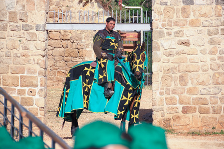 acre: Old Acre, Israel - April 09, 2015: Theatrical knight tournament in Old Acre, Israel Editorial