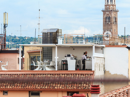 small roof: Verona, Italy, September 26, 2015: Small cafe on the roof of the house on Via Anfiteatro in front Arena in Verona in Verona, Italy