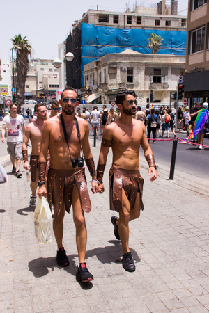 yearly: Tel Aviv, Israel, June 03, 2016: Members of the traditional yearly pride parade surrounded by other people in Tel Aviv, Israel Editorial