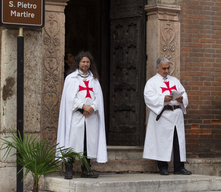 templar: Verona, Italy, September 27, 2015: Two men dressed as Templar stand at the entrance to the church S. Pietro Martire in Verona, Italy