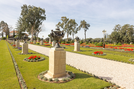 path of crushed stone with trees and shrubs around the edges in Bahai gargen in Acre Stock Photo