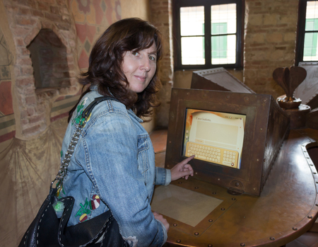 juliet: Verona, Italy - September 26, 2015: A woman writes a letter to Juliet on the home computer in the house of Juliet in Verona, Italy