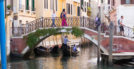 canal street: Venice, Italy, September 28, 2015: Bridge over the canal in a quiet street in Venice, Italy Editorial