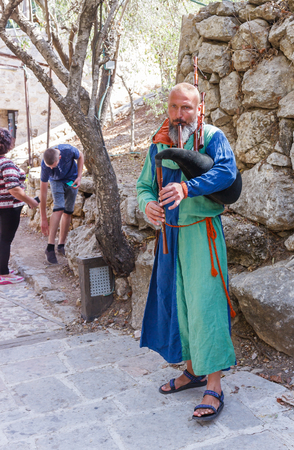 Jerusalem, Israel, October 03, 2016: Member of the annual festival of Knights of Jerusalem playing the bagpipes in Jerusalem, Israel