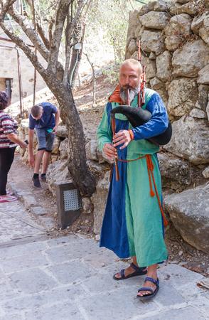 bagpipes: Jerusalem, Israel, October 03, 2016: Member of the annual festival of Knights of Jerusalem playing the bagpipes in Jerusalem, Israel