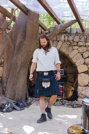 Jerusalem, Israel, October 03, 2016: Member of the annual festival of Knights of Jerusalem, dressed in a Scottish kilt performs a dance in Jerusalem, Israel