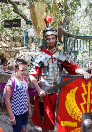 Jerusalem, Israel, October 03, 2016: Member of the annual festival of Knights of Jerusalem dressed in armor Roman soldier posing for photographers in Jerusalem, Israel Editorial
