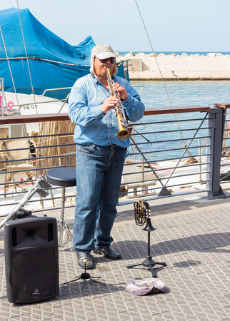 yafo: Yafo, Israel, October 15, 2016: Street musician playing the clarinet on the waterfront in Yafo, Israel Editorial