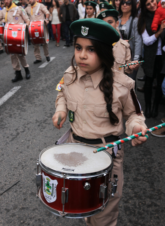 st german: Haifa, Israel - December 17, 2016 : Pupils of St. Elias Episcopal school participate in the Christmas parade in the German Colony in Haifa, Israel