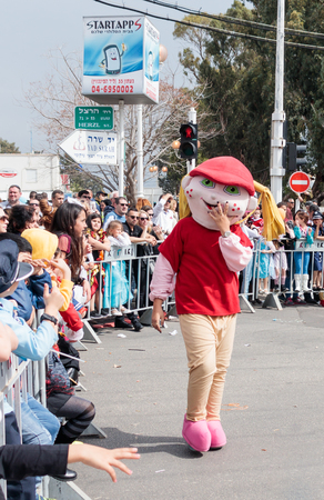 Nahariyya, Israel, March 10, 2017 : Participant in the traditional annual carnival parade Adloyada dressed in the suit of big rabbit goes near the viewers in Nahariyya, Israel