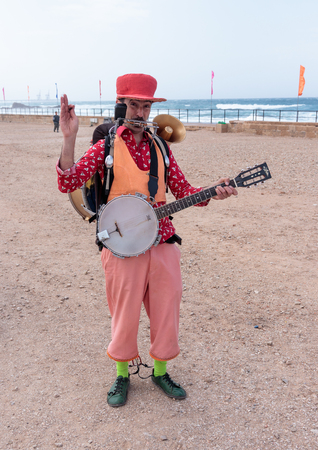 Caesarea, Israel, March 11, 2017 : Participants of the Purim festival who plays several musical instruments shows his art in Caesarea, Israel Editorial