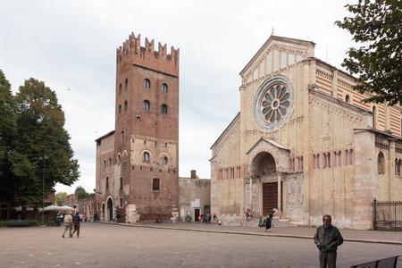 Verona, Italy - September 27, 2015 : Few tourists and passersby walk near the Basilica di San Zeno Maggiore  in Verona, Italy.