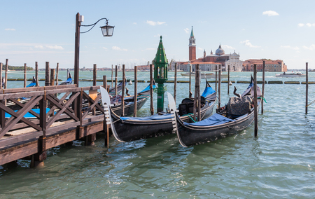residental: Venice, Italy - September 28, 2015 : Water channels of Venice city. Parking gondolas near St. Marks Square on Grand Canal in Venice, Italy.