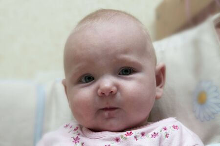 swaddling: Tired little baby girl with funy face expression Stock Photo