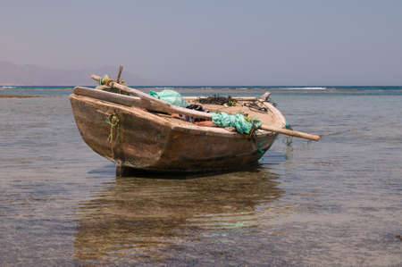Old boat with garbage packs in Red sea photo