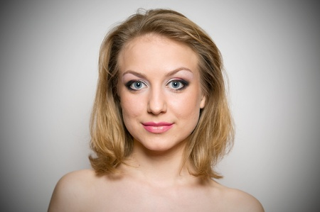 Portrait of a young beautifull blond girl with make-up in studio