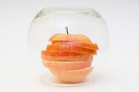 sliced apple: Red sliced apple in vase
