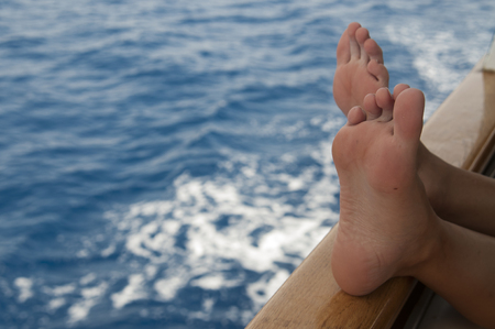 Relaxing on ship while sailing at Adriatic Sea