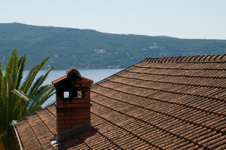Old roof view against islands and sea, Montenegro