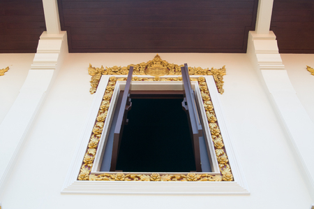 Temple window in Bangkok, Thailand Stock Photo