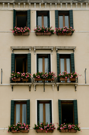 House facade with balcony full of flowers in Venice Stock Photo
