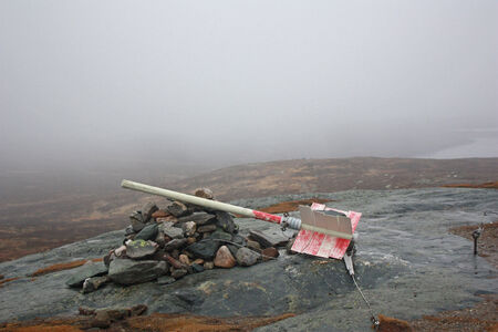 lonelyness: Fallen sign on top of the mountain in the fog