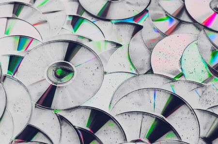 Group of old CD DVD compact optical disk storage medium with dust and scratches. Abstract grunge processing 版權商用圖片