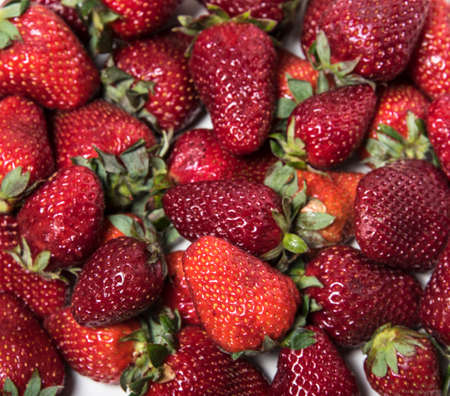 The mixture of strawberries on the white background