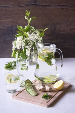 Still life with refreshing water and bird cherry in the background. Early morning.