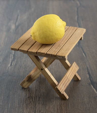lemon wedge: Lemon on a small wooden table wooden background