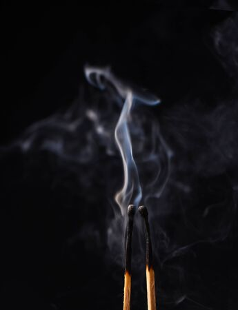 Smoke from two burnt wooden matches close up Stock Photo
