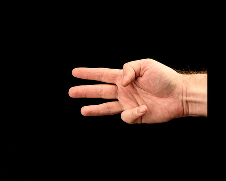 Male hand shows score or number three