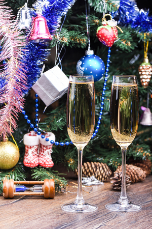 Glasses with champagne on the background of a decorated Christma