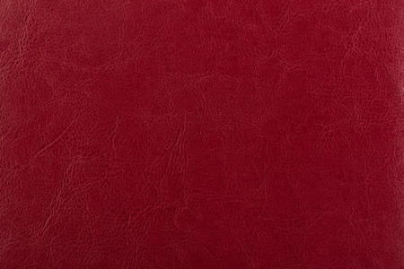 Dark red leather surface as a background, leather texture. Skin Stock Photo