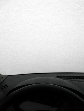 Shield of ice and snow on the windshield of the car. View from t