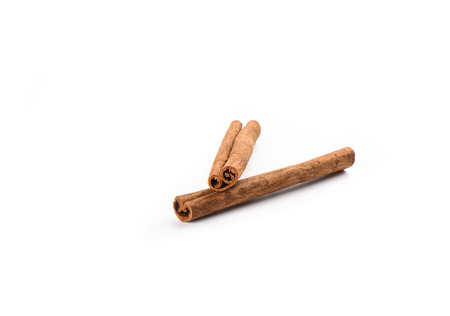 Two cinnamon sticks isolated on white background. Spice concept. Copy space
