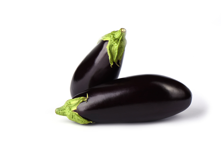 Two eggplants or aubergines isolated on white background. Copy space Stock Photo
