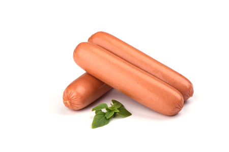 Three fresh boiled sausages and basil isolated on white background. Copy space