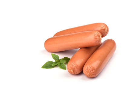 Four fresh boiled sausages and basil isolated on white background. Copy space Stock Photo