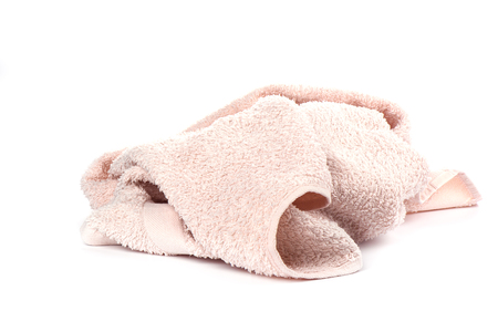 Light pink terry towel isolated on white background. Close up. Copy space Фото со стока